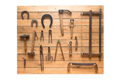 Vintage set of tools is located on a wooden board. Isolated on w Stock Photography
