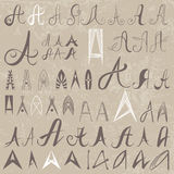 Vintage Set of 50 varied hand drawing letters A. On old paper background. Can be used as elements of logo design Stock Photos