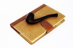 Vintage setting of pipe and diary Royalty Free Stock Photo