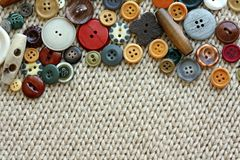 Vintage Sewing Buttons Framing Fabric Background