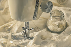 Vintage Sewing Machine. With buttons and wedding dress fabric Royalty Free Stock Photography