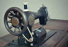 Vintage Sewing machine. At home Royalty Free Stock Photo