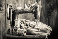 Vintage sewing machine with needle, threads and tailor tape Royalty Free Stock Photography