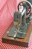 Vintage Sewing Machine. This photo shows a well used vintage 1920s sewing machine. This photo could be used to promote similar collectable items of the time Royalty Free Stock Photos