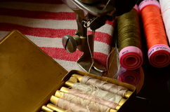 Vintage sewing machine and  set of thread spools Stock Photo