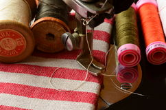 Vintage sewing machine and  thread spools Stock Image