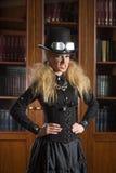 Vintage sexy girl next to the bookcase, gothic Royalty Free Stock Photos