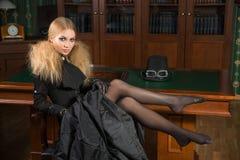 Vintage sexy girl next to the bookcase, gothic Stock Photos