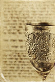 Vintage shabbath silver cup of wine in front of torah prayer book Stock Image