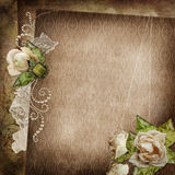 Vintage shabby background with faded roses, brooch and lace. Old lace, brooch, strings of pearls, withered roses on vintage background Stock Photography