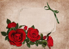 Vintage shabby background with red roses and a card Stock Photos