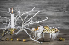 Vintage or shabby chic christmas background with one burning can Royalty Free Stock Image