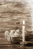 Vintage or shabby chic christmas background with one burning can Stock Photos