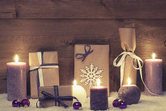 Vintage And Shabby Chic Purple Christmas Gifts With Candles Stock Photo