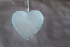 Vintage shabby hearts on the background of old paper. Soft focus, background mode stock images