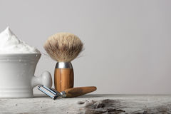 Vintage Shaving Equipment on white Table and bright Background. Vintage wet Shaving Equipment on white Table royalty free stock image