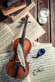 Vintage sheets and violin Stock Photography