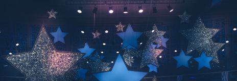 Vintage shining stars shape spotlights soffits night show stage performance background with gradient dark blue pink lilac purple l. Shining stars shape royalty free stock images