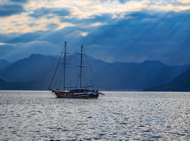 Vintage ship sailing with sun rays. Stock Photo