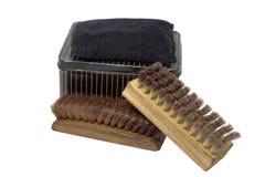 Vintage shoe shine kit with metal polish holder pad and brushes Royalty Free Stock Image