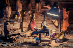 Vintage shoemaker workplace with brush and shoes Stock Images