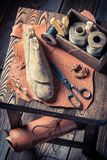 Vintage shoemaker workshop with leather and tools. On wooden table royalty free stock images