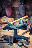 Vintage shoemaker workshop with tools, shoes and leather Royalty Free Stock Photography
