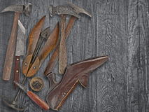 Vintage shoemakers tools and shoe Royalty Free Stock Image