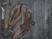 Vintage shoemakers tools and shoe Royalty Free Stock Photos