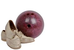 Vintage Shoes and Bowling Ball. Old pair of women\'s white bowling shoes and an old bowling ball Royalty Free Stock Photography