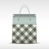 Vintage shopping bag in check texture Stock Photography