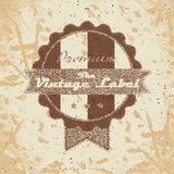 Vintage shopping heraldic label on faded paper Royalty Free Stock Image