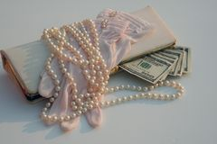 Vintage shopping money. Retro purse with pearls gloves and money stock photos