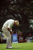 Vintage Shot of Jack Nicklaus putting. Royalty Free Stock Image