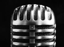 Vintage shure microphone. On black background Royalty Free Stock Photography