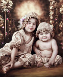 Vintage siblings. Vintage style dressed sister and brother Royalty Free Stock Photography