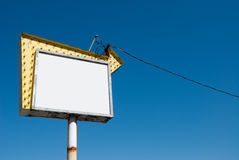 Vintage Sign on a Blue Sky Stock Images