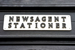 Vintage sign. A vintage sign for a newsagent and stationery store in the UK stock images