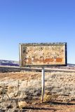 Vintage sign of old meadows riding club used as target practice on old Route 66, New Mexico. royalty free stock images