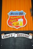 Route 66 Vintage Sign, Burgers and Cold Beer, Chef`s Special, Food and Beverages Business. Vintage sign from Route 66, hanging in a Motorcycle Club House front Stock Photography