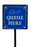 Vintage sign saying please queue here Stock Image