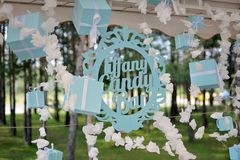 Vintage sign `Tiffany Candy Bar` with gift boxes. Vintage sign Tiffany Candy Bar with gift boxes, hanging forward of nature Royalty Free Stock Image