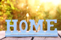 Vintage sign with the word HOME over wooden table Stock Image