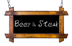 Vintage sign with the words beer and steaks. Isolated on white Royalty Free Stock Photos