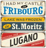 Vintage signs collection with cities and tourist attractions in Switzerland. Travel souvenirs on grunge damaged background Royalty Free Stock Image