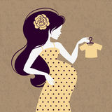 Vintage silhouette of pregnant woman. With baby's loose jacket Stock Photos
