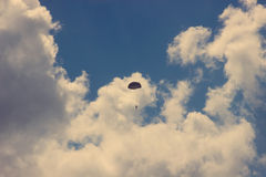 vintage Silhouette of skydiver at blue sky Royalty Free Stock Photo