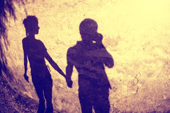 Vintage silhouette of two people holding hands Royalty Free Stock Images
