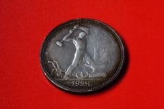 Vintage silver coin on red background Royalty Free Stock Photo