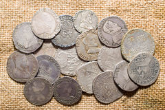 Vintage silver coins with portraits on the old cloth Stock Photo